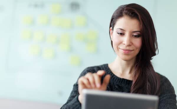 woman on tablet smiling